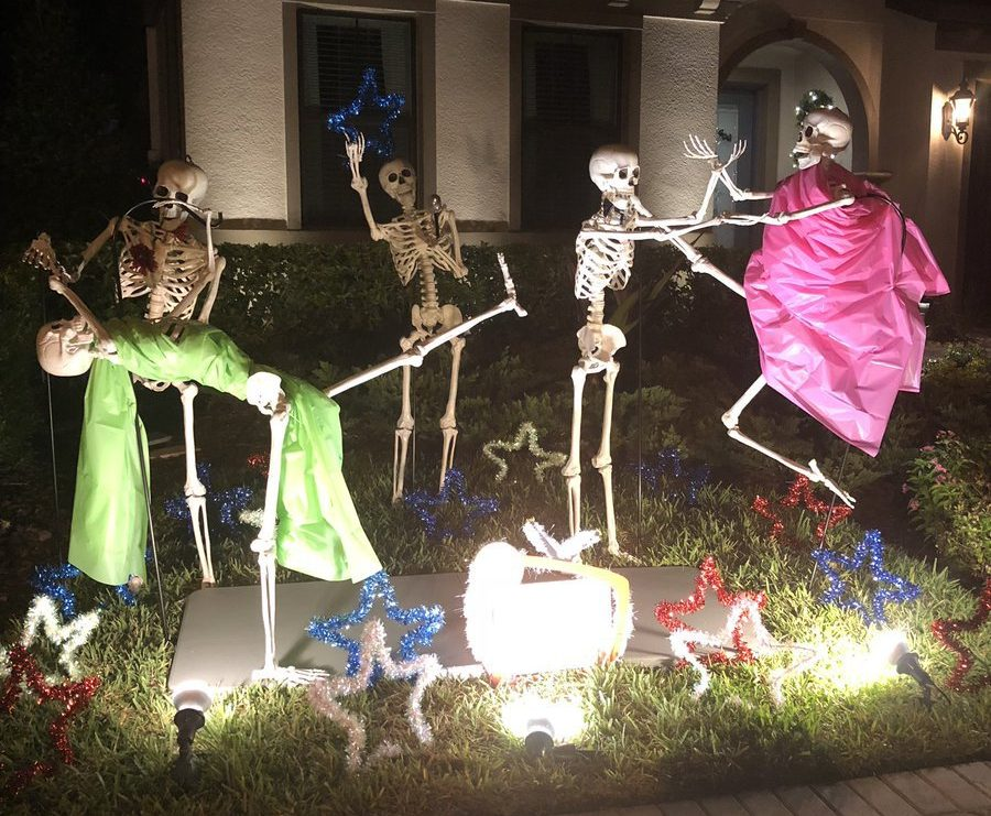 Girl's neighbours put on spectacular skeleton display that changes every day for Halloween