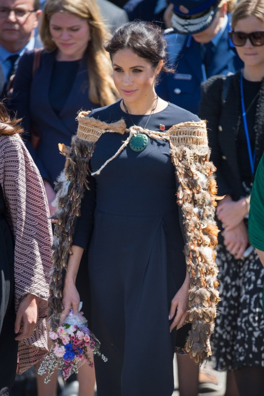 The Duchess of Sussex wears a traditional Maori cloak called a Korowai during a visit to Te Papaiouru, Ohinemutu, in Rotorua, before a lunch in honour of Harry and Meghan, on day four of the royal couple's tour of New Zealand. PRESS ASSOCIATION Photo. Picture date: Wednesday October 31, 2018. See PA story ROYAL Tour. Photo credit should read: Dominic Lipinski/PA Wire