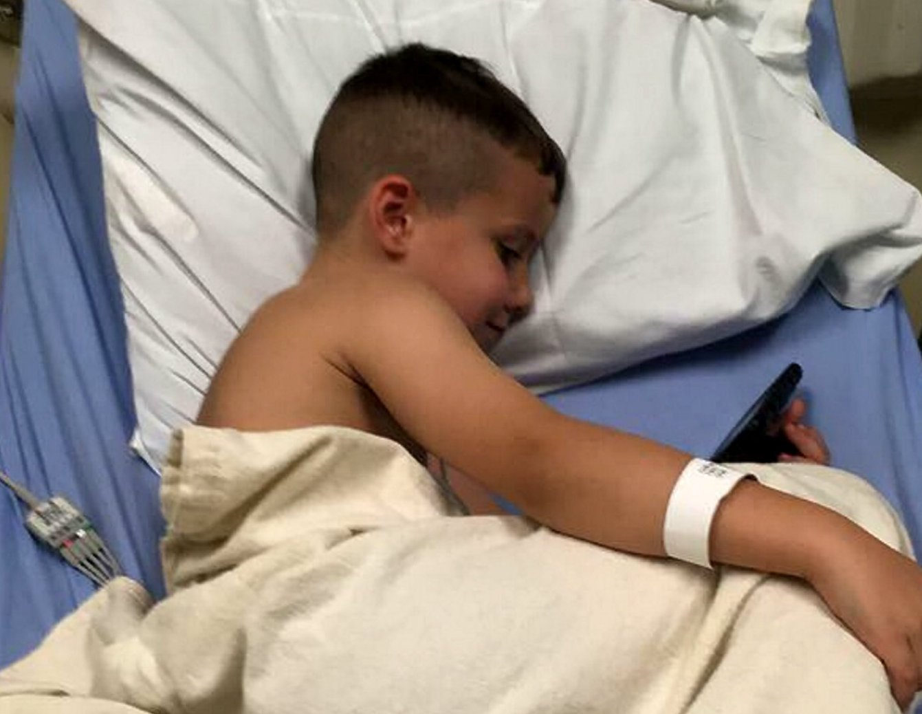 Braylen Pence, 5, at Galion Community Hospital after testing positive for METH in the aftermath of an afternoon of trick-or-treating. Galion, Ohio. October 28 2018. See SWNS story SWNYmeth. A mom has spoken about the terrifying moment her five-year-old son tested positive for METH after an afternoon of trick-or-treating. Braylen Pence suffered a seizure when he accidentally consumed the Class A drug while going door-to-door asking for Halloween candy with his dad Cambray Carwell, 24, a factory worker. The poorly boy was taken to Galion Community Hospital where his urine samples tested positive for methamphetamine, the highly addictive and dangerous substance better known as Crystal Meth. Julia Pence, 25, a gas station cashier from Mount Gilead, Ohio, arrived at the hospital to find her son disorientated and aggressive.