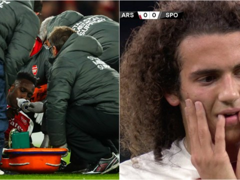 Injured Arsenal star Danny Welbeck stretchered off the pitch after receiving oxygen
