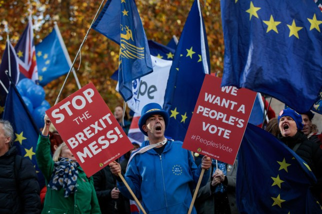 Anti-Brexit campaigners shout slogans outside the Houses of Parliament in the Westminster district of London, U.K., on Monday, Nov. 19, 2018. Ever since Prime MinisterTheresa Mayannounced her Brexit deal, she has sought to go over the heads of her critics and appeal directly to voters to back her plan. Photographer: Simon Dawson/Bloomberg via Getty Images