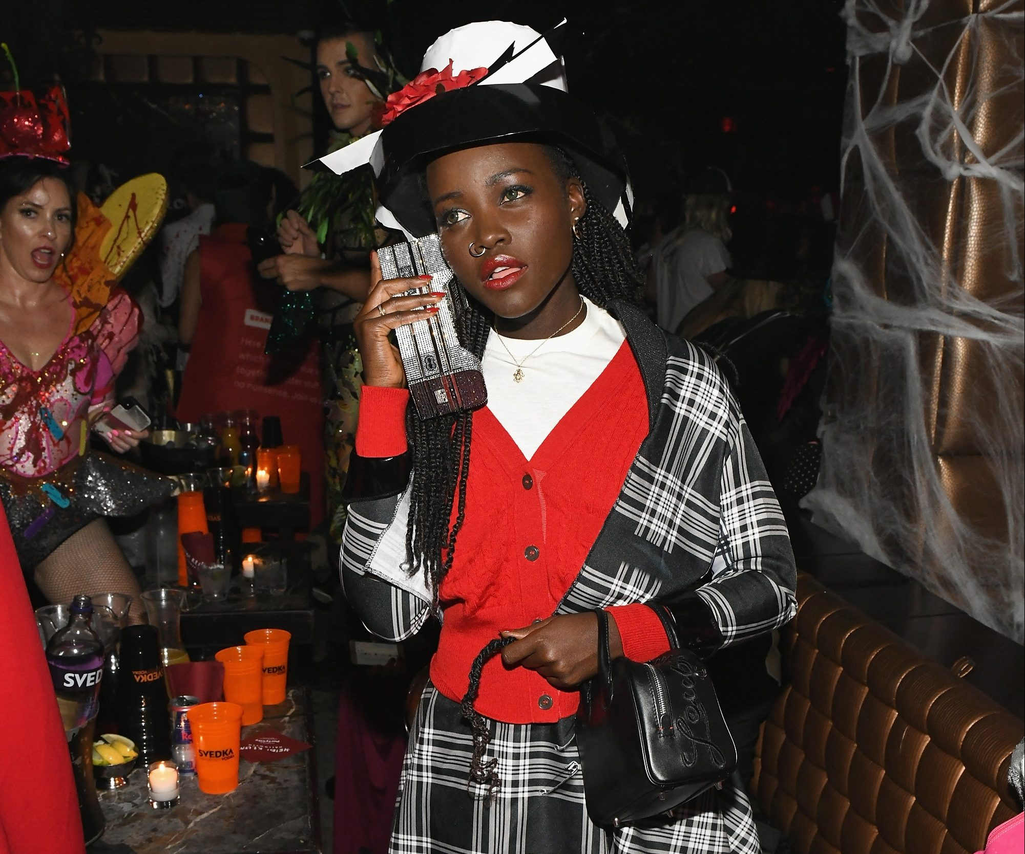 Lupita Nyong'o dressed as Dionne from Clueless and it was like totally iconic