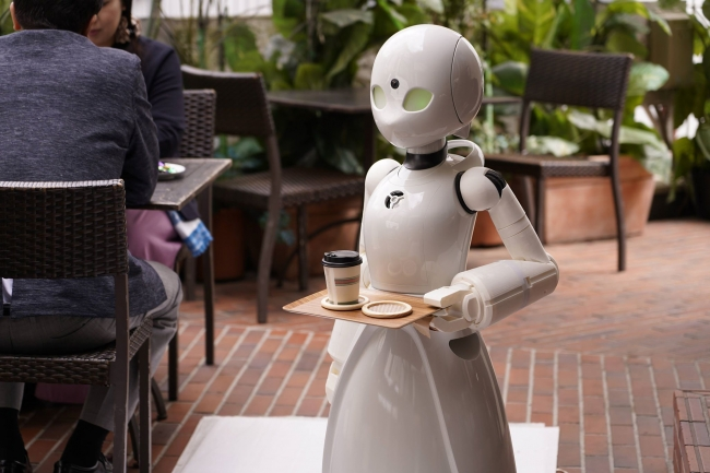 Cafe staffed by robots controlled by paralysed people opens its doors