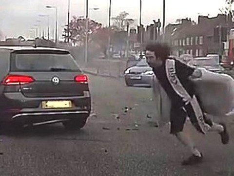Man in pink bathrobe 'caught legging it' from car crash