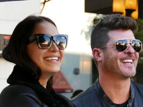 Robin Thicke and pregnant girlfriend April Love Geary put on a brave face after losing home in California wildfires