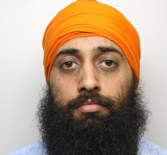 """Amere Singh Dhaliwal is shown in a police mugshot, in connection with a large scale rape and sexual abuse trial which sees 16 asian men from the Kirklees area jailed for a total of 221 years, at Leeds Crown Court, West Yorks., October 19 2018. See SWNS story SWLEabuse: A 16-strong gang of Asian men have been jailed for 221 years for drugging and sexually abusing vulnerable girls as young as eleven years old. The perverted group of men sexually abused the young victims, including two who had learning difficulties, between 2004 and 2011. The """"cynical"""" exploitation of the girls - between just 11 and 17 years old - included plying them with alcohol and drugging them before carrying out horrific sexual assaults."""