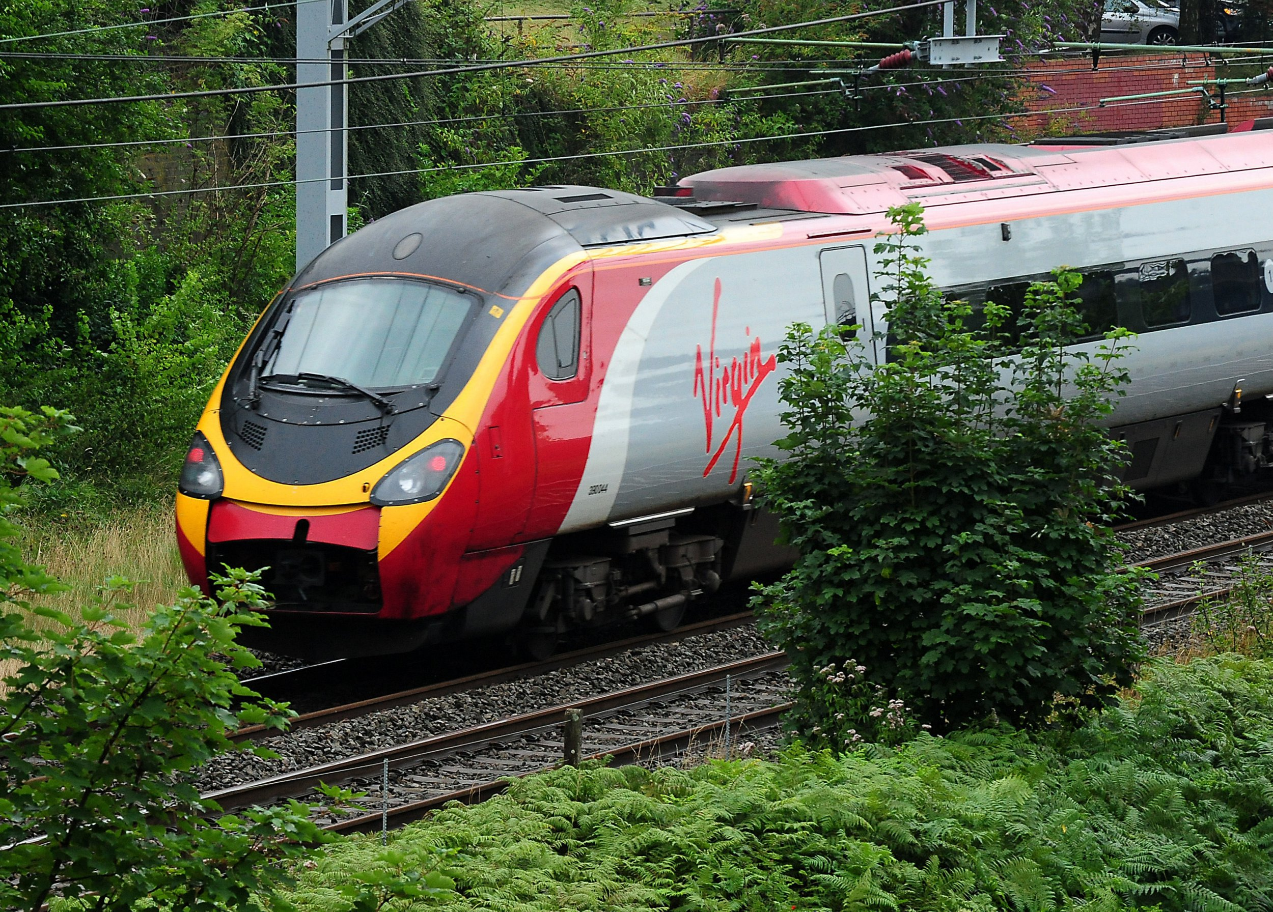 Embargoed to 1300 Thursday November 01 File photo dated 15/08/12 of a Virgin train, as the company has permanently scrapped its Friday afternoon peak restrictions from London Euston to ease overcrowding and enable weekend getaways to start earlier. PRESS ASSOCIATION Photo. Issue date: Thursday November 1, 2018. The huge difference in many peak and off-peak fares previously led to huge demand for the first Friday night off-peak trains at around 7pm. See PA story RAIL Virgin. Photo credit should read: Rui Vieira/PA Wire