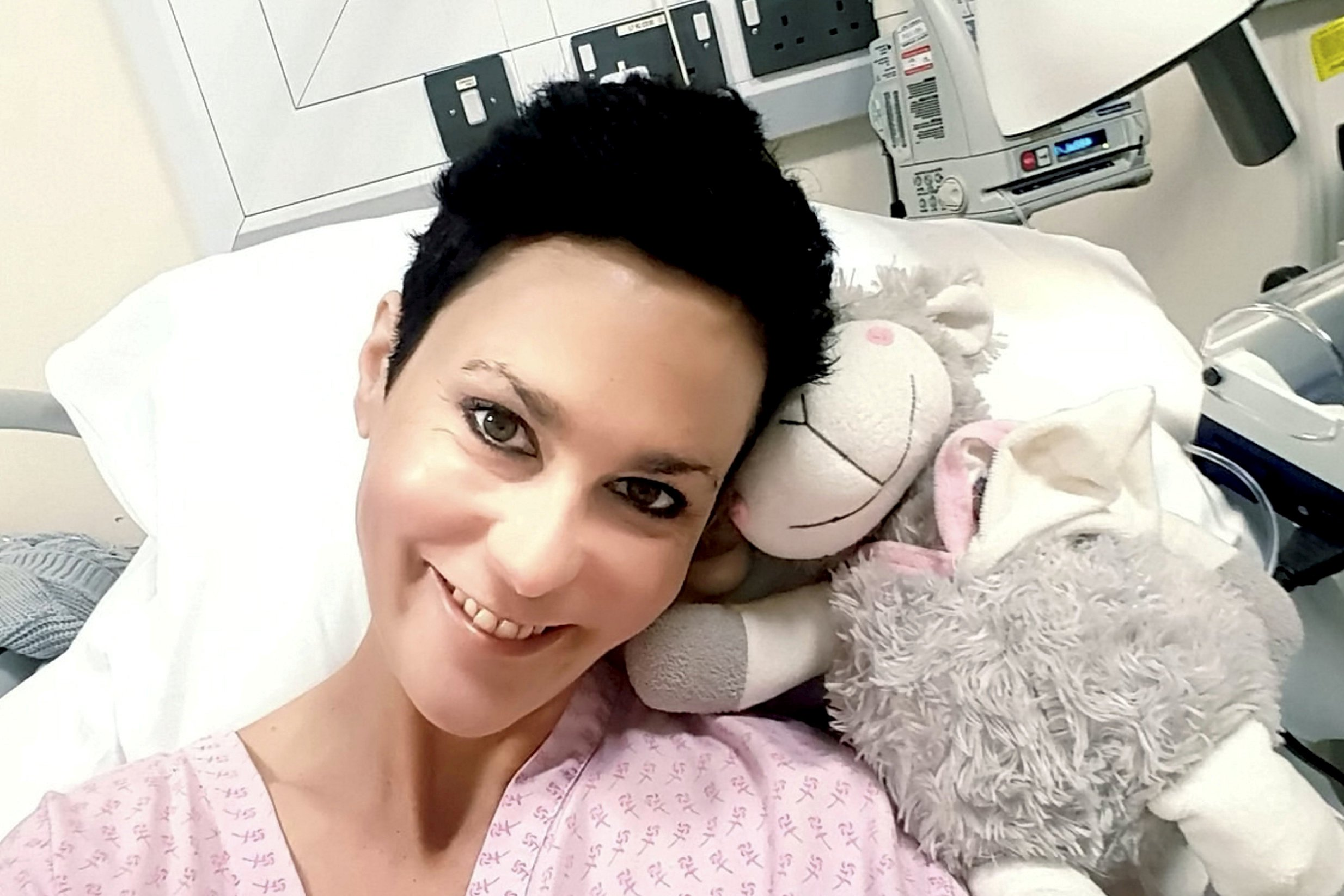 Laura Harris receiving treatment at hospital. (file photo) SWPLcancer; Tributes paid to oncology nurse forced to fundraise for treatment not available to her on NHS after she died.