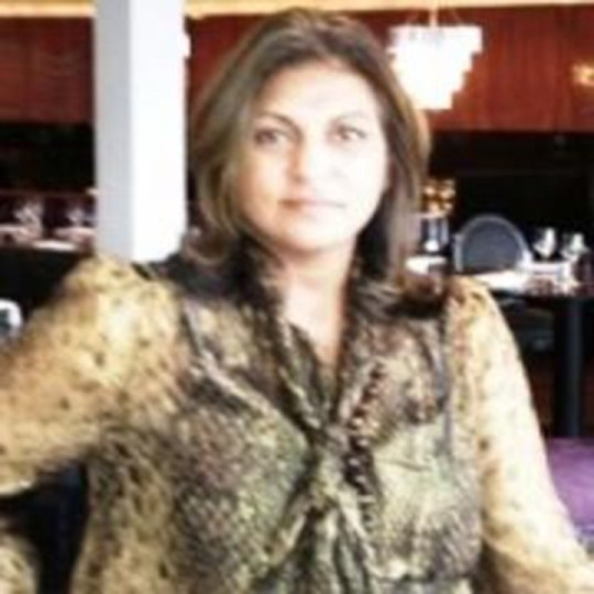 "Shows: Pritpal Binning, 56 - ID confirmed by Tom Witherow The couple arrested in the modern slavery investigation were today named locally as Pritpal Binning, 56, and her 54 year old husband Palvinder, who have been having work done to their ?1.2 million home in Chilworth. Mrs Binning, a lecturer in health sciences at the University of Southampton, Hants, today refused to comment on her and her husband's arrest. Speaking at her home, she said: ""I know why you're here. We're not going to talk. ""You just want a story, I'm not going to talk about it."" A male neighbour in his 40s, said he had seen a white man working around the five-bedroom property but was shocked to hear of the allegations about the 'nice' couple. He said: ""I did go round there once, a few years back. They've lived here for at least 20 years - they were certainly nice when I went round there. ""I saw the police there the other day and one of the vans actually parked outside my house for a little while."