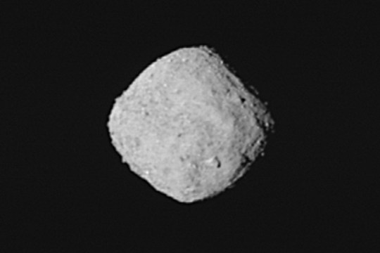 "This ""super-resolution? view of asteroid Bennu was created using eight images obtained by NASA?s OSIRIS-REx spacecraft on Oct. 29, 2018, from a distance of about 205 miles (330 km). The spacecraft was moving as it captured the images with the PolyCam camera, and Bennu rotated 1.2 degrees during the nearly one minute that elapsed between the first and the last snapshot. The team used a super-resolution algorithm to combine the eight images and produce a higher resolution view of the asteroid. Bennu occupies about 100 pixels and is oriented with its north pole at the top of the image.Credit: NASA/Goddard/University of Arizona"