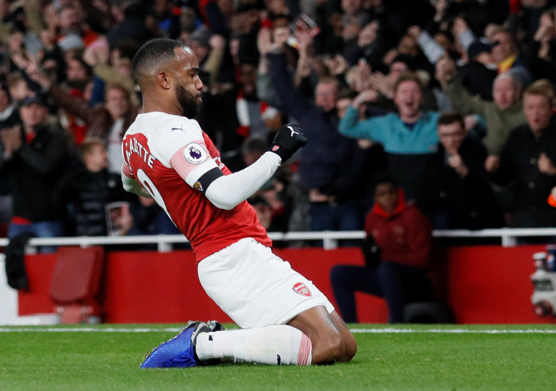 """Soccer Football - Premier League - Arsenal v Liverpool - Emirates Stadium, London, Britain - November 3, 2018 Arsenal's Alexandre Lacazette celebrates scoring their first goal REUTERS/David Klein EDITORIAL USE ONLY. No use with unauthorized audio, video, data, fixture lists, club/league logos or """"live"""" services. Online in-match use limited to 75 images, no video emulation. No use in betting, games or single club/league/player publications. Please contact your account representative for further details."""