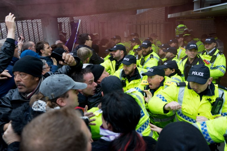 """LIVERPOOL, MERSEYSIDE, UNITED KINGDOM - NOVEMBER 03: Anti Facsist protestors are pushed by Riot Police as they use the technique called kettling to surround a group of members and supporters of the far right group Merseyside Frontline Patriots who had come to the city to hold a """"Pro Brexit British Independance Rally"""". The hundreds of anti-facsist protestors who had turned up at Moorfield Railway Station to meet them ensured that the small group was unable to march through the city. The anti-fascist protestors thern marched through the city to Lime Street Station, in Liverpool on November 03, 2018.PHOTOGRAPH BY Jim Wood / Barcroft Images"""