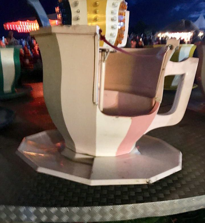 """Three girls were hurt when a fairground teacup ride came loose and """"spun into a crowd"""". Parents screamed as the cup broke away from its platform at Leeds Castle, near Maidstone, on Saturday."""