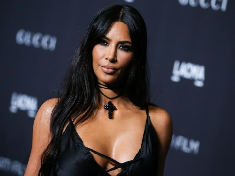 Kim Kardashian poses for selfie with Travis Barker's son amid rumours Blink-182 drummer is dating Kourtney