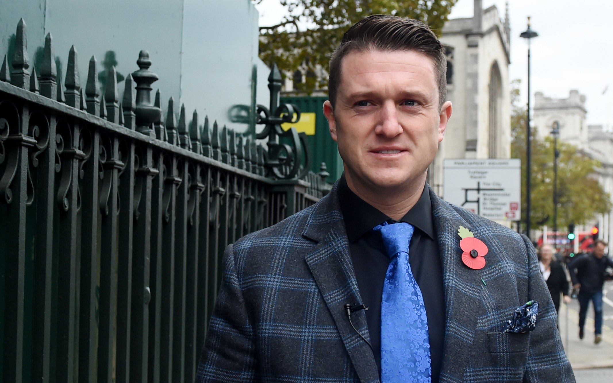 epa07145446 Far right activist, known as Tommy Robinson, (Stephen Christopher Yaxley-Lennon) outside the British Houses of Parliament in central London, Britain, 06 November 2018. EPA/FACUNDO ARRIZABALAGA