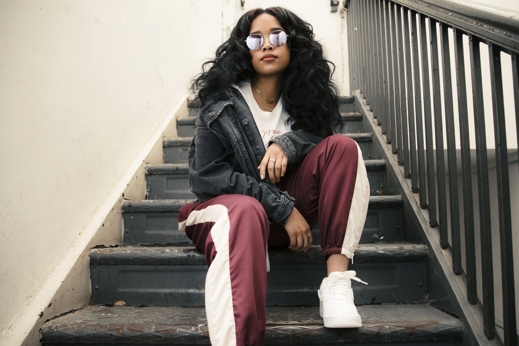 In this Aug. 13, 2018 photo, R&B singer Gabi Wilson, better known as H.E.R., poses for a portrait in New York. She is Apple Music???s latest ???Up Next??? artist and ranks sixth among R&B artists on the streaming platform. (Photo by Victoria Will/ Invision/AP)