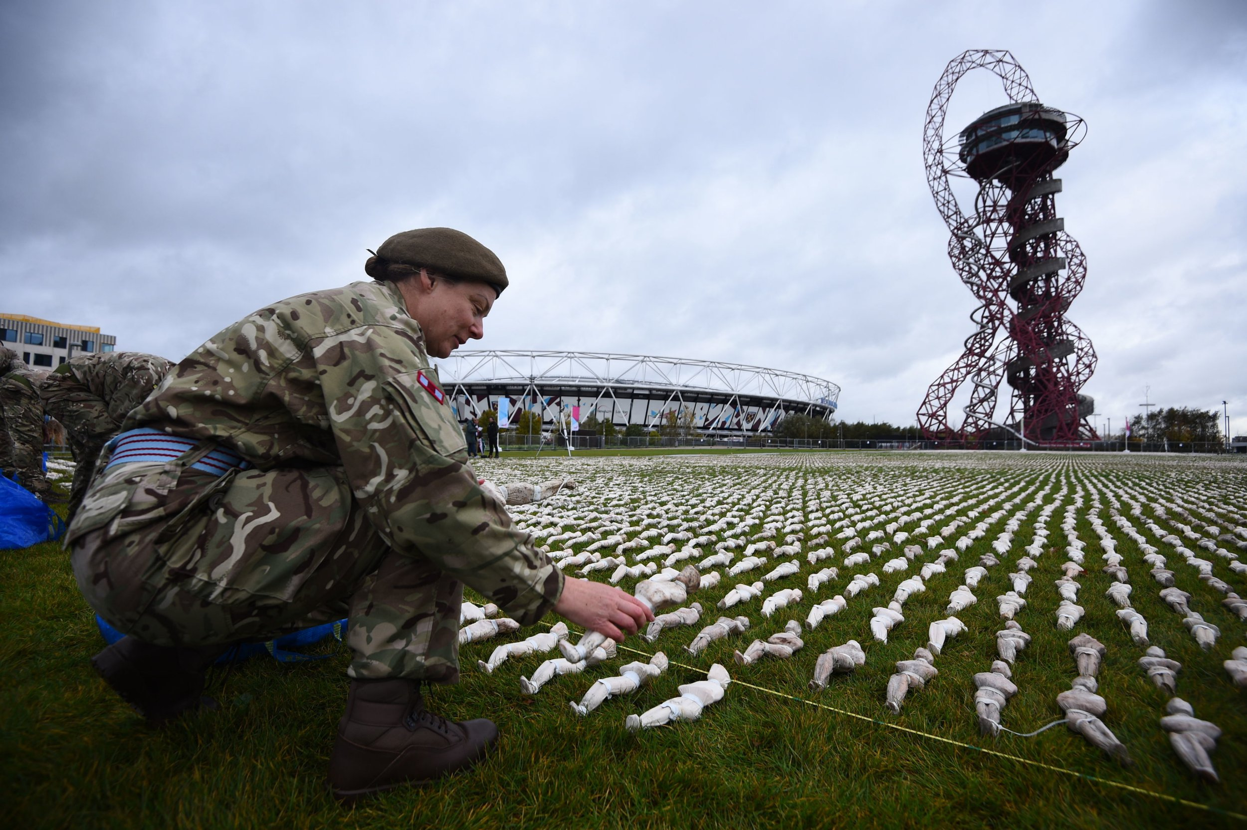A figure is placed in Rob Heard's Shrouds of the Somme installation, honouring the dead of the First World War, at the Queen Elizabeth Olympic Park in London. PRESS ASSOCIATION Photo. Picture date: Wednesday November 7, 2018. 72,396 small shrouded figures, representing soldiers who died and were never recovered from the Somme battlefields, have been laid out by volunteers and members of 1 Royal Anglian Regiment. Photo credit should read: Kirsty O'Connor/PA Wire