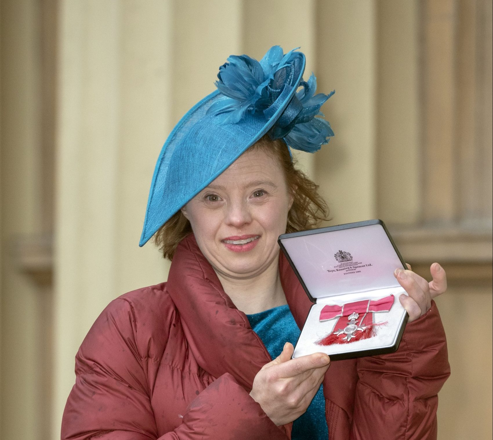 LONDON, ENGLAND - NOVEMBER 7: Sarah Gordy leaves Buckingham Palace after receiving her MBE (Member of the Order of the British Empire) at an Investiture ceremony on November 7, 2018 in London, England. The Call The Midwife actress has become the first woman with Down's syndrome to receive an MBE. (Photo by Steve Parsons - WPA Pool/Getty Images)