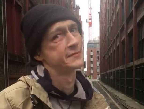 This footage shows the moment an injured homeless man was told to move from an unused doorway outside retail giant Boohoo's head office as he tried to warm up with a coffee. A member of security staff from the online retailer office on Dale Street in Manchester's trendy Northern Quarter can be seen guarding the closed shutter where the man had been resting. Caption: Homeless man Tom, who was asked to move from an unused doorway outside Boohoo's office on Dale Street in Manchester's Northern Quarter