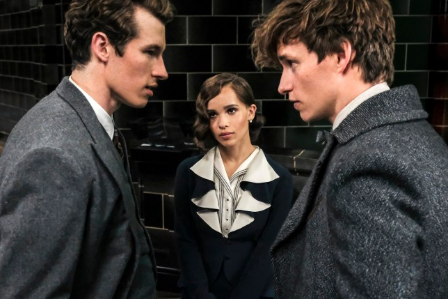 "This image released by Warner Bros. Pictures shows Callum Turner, from left, Zoe Kravitz and Eddie Redmayne in a scene from ""Fantastic Beasts: The Crimes of Grindelwald."" (Jaap Buitendijk/Warner Bros. Pictures via AP)"