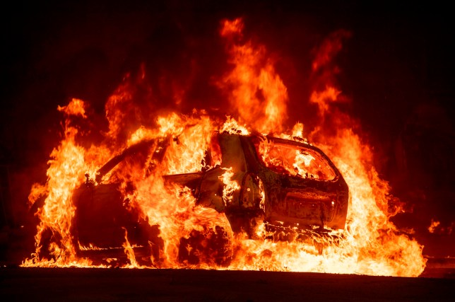 A car explodes into flames as the Camp fire tears through downtown Paradise, California on November 8, 2018. - A rapidly spreading, late-season wildfire in northern California has burned 20,000 acres of land and prompted authorities to issue evacuation orders for thousands of people. (Photo by Josh Edelson / AFP)JOSH EDELSON/AFP/Getty Images