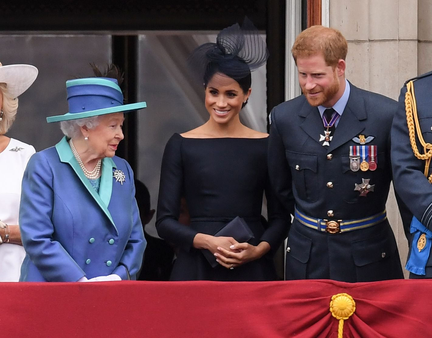Mandatory Credit: Photo by David Fisher/REX/Shutterstock (9753789x) Queen Elizabeth II, Meghan Duchess of Sussex and Prince Harry on the balcony of Buckingham Palace 100th Anniversary of the Royal Air Force, London, UK - 10 Jul 2018