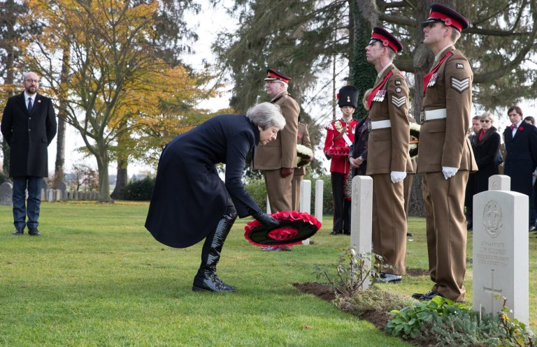 epa07152980 British Prime Minister Theresa May lays a wreath watched by Belgian Prime Minister Charles Michel (L) during the commemoration of the 100th anniversary of the end of the First World War at the Saint-Symphorien Military Cemetery, in Saint-Symphorien, Mons Belgium 09 November 2018. The cemetery at St. Symphorien was established by the German Army in August 1914 as the final resting place for British and German soldiers who were killed in the Battle of Mons. Among those buried here is Private John Parr of the Middlesex Regiment who was fatally wounded during an encounter with a German patrol two days before the battle, thus becoming the first British soldier to be killed in action on the Western Front. The cemetery remained in German hands until the end of the war and also contains the graves of Commonwealth and German soldiers who were killed in the final days of the conflict, including George Ellison of the Royal Irish Lancers and George Price of the Canadian Infantry. Ellison and Price were killed on Armistice Day 11 November 1918 and are believed to be the last Commonwealth casualties of the First World War. In total, there are 284 German and 230 Commonwealth casualties buried in this site. EPA/BENOIT DOPPAGNE / POOL