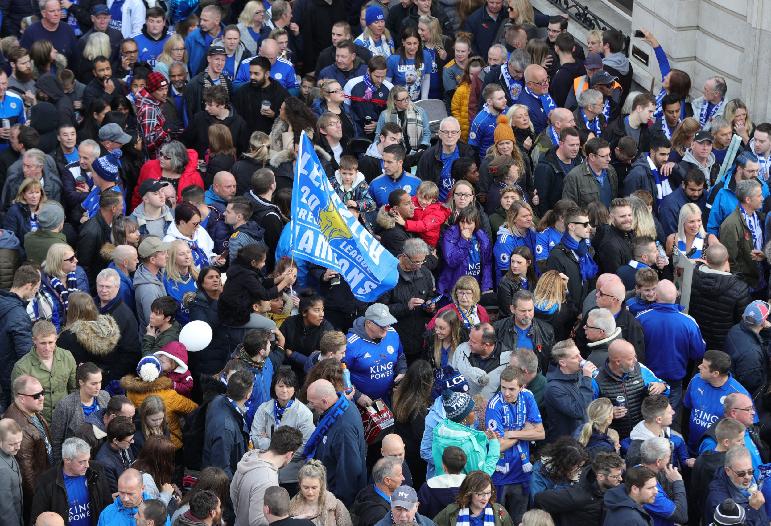 Leicester City fans gather at Jubilee Square in Leicester, before taking part in a memorial walk to the King Power Stadium, in honour of the club's owner Vichai Srivaddhanaprabha and four others who died in a helicopter crash outside the stadium on October 27. PRESS ASSOCIATION Photo. Picture date: Saturday November 10, 2018. See PA story SOCCER Leicester. Photo credit should read: Aaron Chown/PA Wire