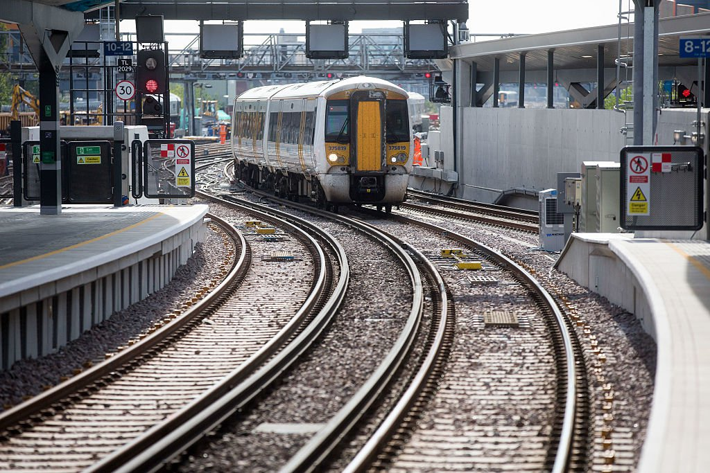 A train waits to enter a newly opened platform at London Bridge railway station in London, U.K., on Wednesday, Aug. 31, 2016. London Bridge, the city's fourth-busiest station, is enduring a capacity squeeze that last year saw police hold back commuters from packed platforms as a radical remodeling linked to construction of the Shard skyscraper prevents the operation of the 24 trains an hour stipulated in the franchise terms. Photographer: Simon Dawson/Bloomberg via Getty Images