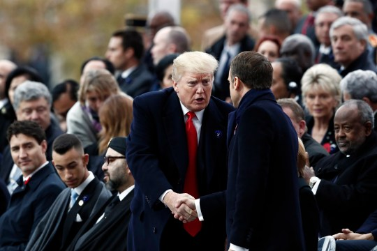 epa07157756 French President Emmanuel Macron (R) shakes hands with U.S. President Donald Trump (L) as they attend the international ceremony for the Centenary of the WWI Armistice of 11 November 1918 at the Arc de Triomphe, in Paris, France, 11 November 2018. World leaders have gathered in France to mark the 100th anniversary of the First World War Armistice with services taking place across the world to commemorate the occasion. EPA/BENOIT TESSIER / POOL MAXPPP OUT