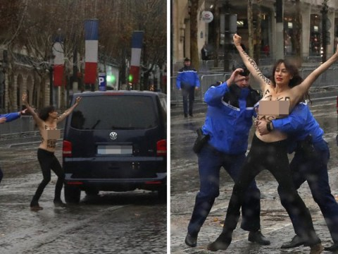 Topless protesters run at Donald Trump's car on way to memorial service