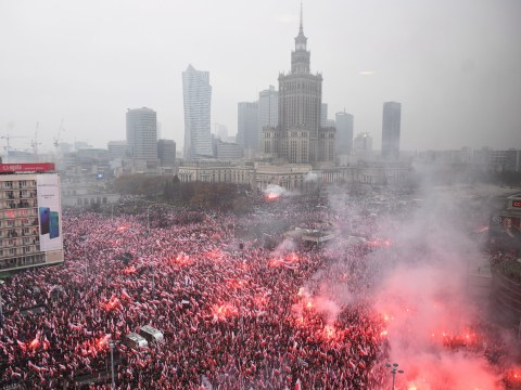 Polish leaders march alongside far right groups burning flares for Independence Day