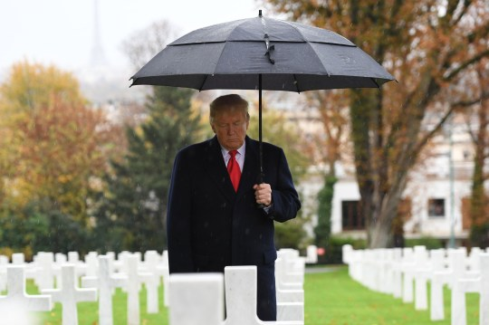 US President Donald Trump takes part in a ceremony at the American Cemetery of Suresnes, outside Paris, on November 11, 2018 as part of Veterans Day and commemorations marking the 100th anniversary of the 11 November 1918 armistice, ending World War I. (Photo by SAUL LOEB / AFP)SAUL LOEB/AFP/Getty Images