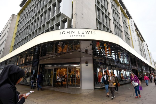 """Mandatory Credit: Photo by Stephen Chung/LNP/REX/Shutterstock (9868529d) Rebranding has taken place at the flagship Oxford Street department store of John Lewis. John Lewis rebrands to John Lewis & Partners, London, UK - 05 Sep 2018 Now known as """"John Lewis & Partners"""", the rebranding puts the group's 83,000 staff, known internally as partners, at the """"heart of the business"""" and will take five years to roll out across stores nationwide. Waitrose will also rebrand to """"Waitrose & Partners"""" as the group faces increasing challenges in the high street."""