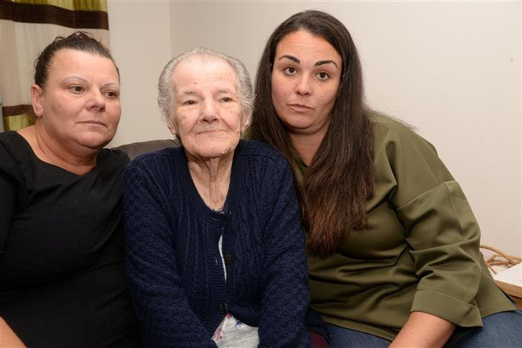 Beryl Harris, 87 of Leysdown, with daughter and granddaughter Tina and Gemma Cunningham. See National News story NNnan; A pensioner with Alzheimer's spent hours locked in a charity minibus after the driver forgot about her - and went home for the weekend. The family of grandmother Beryl Harris, 87, fear she could have died after she spent more than three hours abandoned in the Age UK bus after dozing off. Beryl was left behind by the driver, who forgot to take her home, then returned to a centre run by the charity on a Friday night, locked up the van and left. Her family claim after she was found Age UK staff joked about the ordeal, because they speculated that Beryl had had a nap.