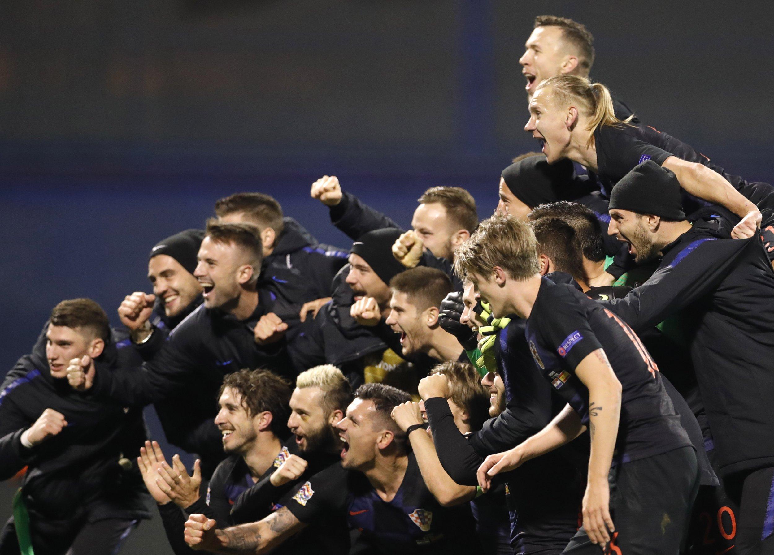 epa07168179 Croatia's soccer players celebrate winning against Spain during the UEFA Nations League' A Group group 4 soccer match between Croatia and Spain at Maksimir stadium in Zagreb, Croatia, 15 October 2018. EPA/ANTONIO BAT