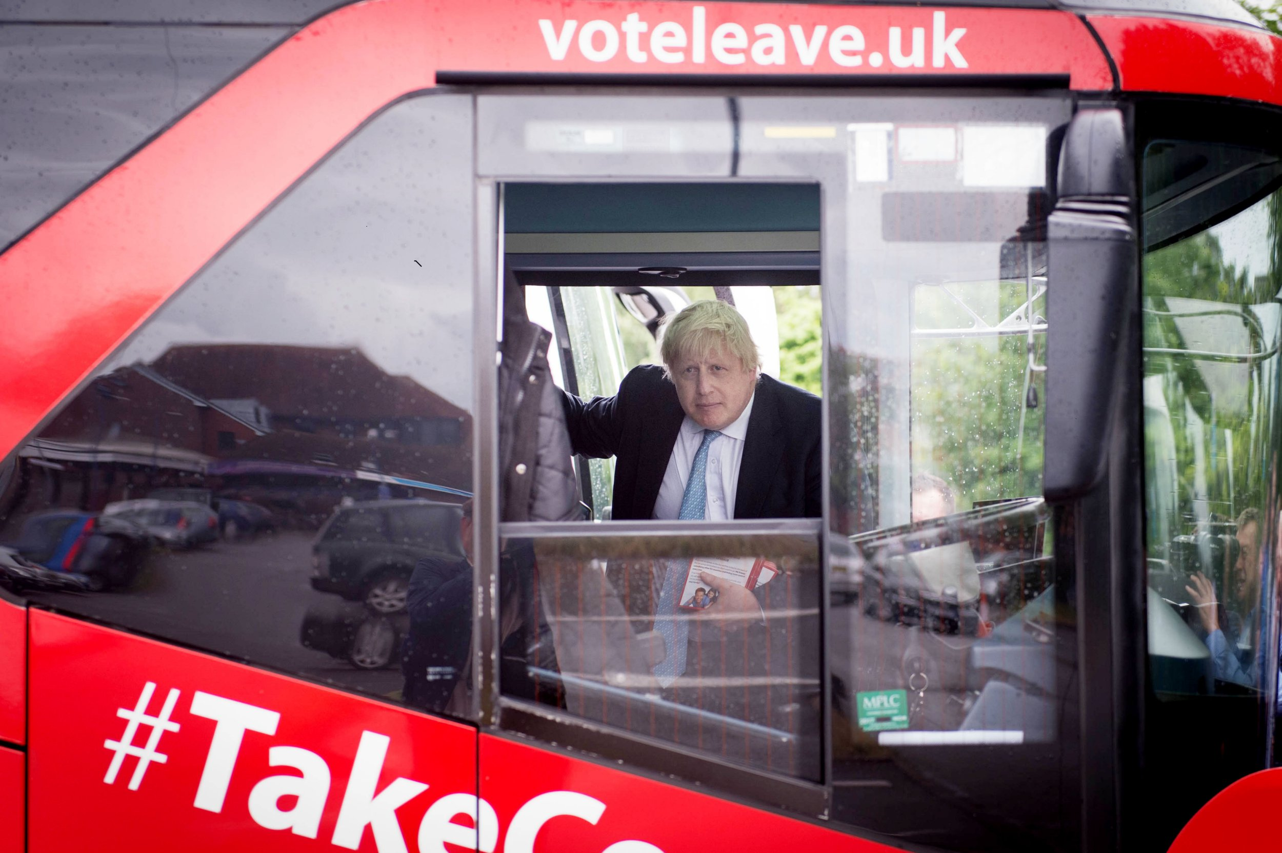 Boris Johnson look out from the Vote Leave bus in Henley in Berkshire, during a day of campaigning, as part of the Vote Leave EU referendum campaign.
