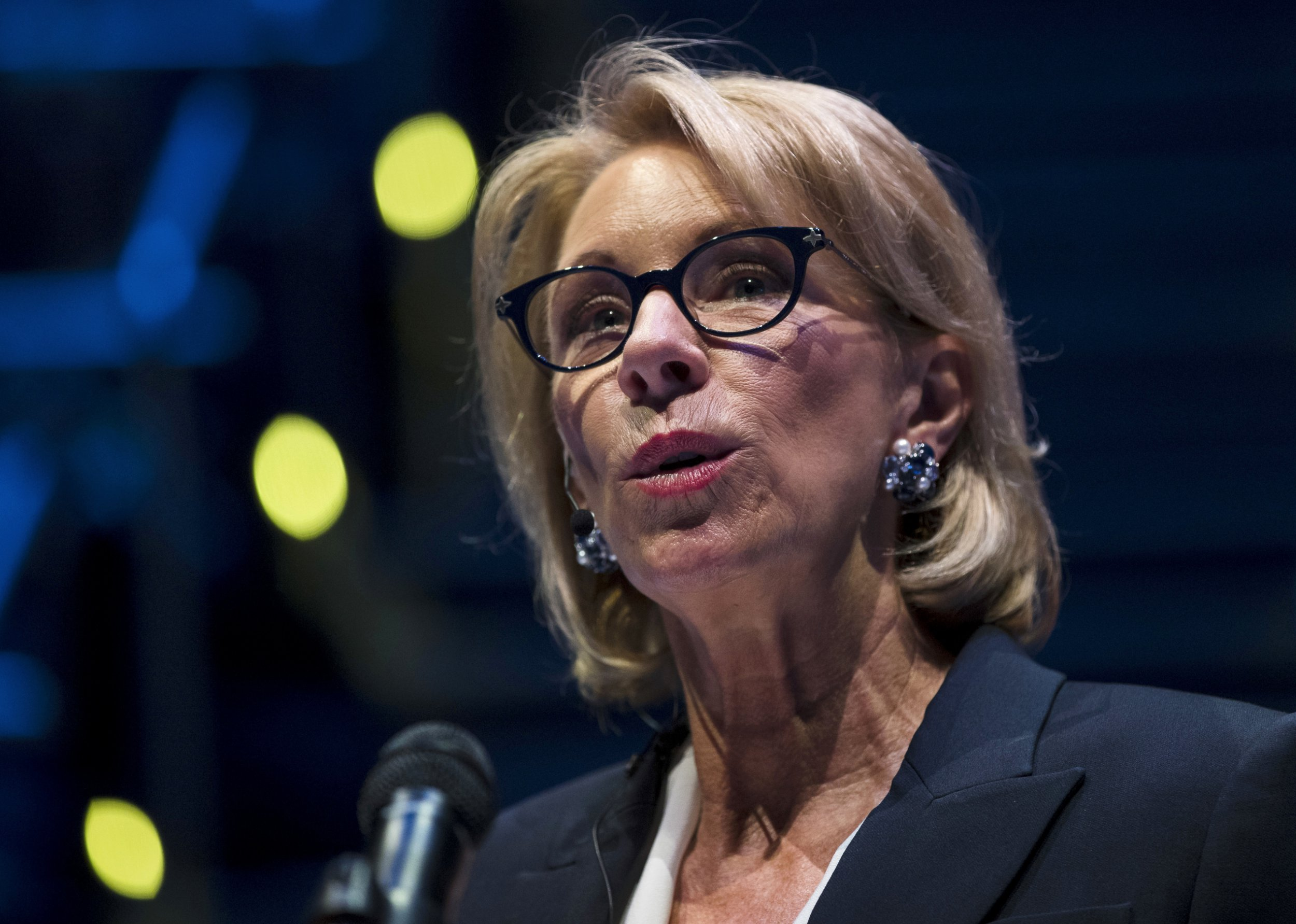 In this Sept. 17, 2018 photo, Education Secretary Betsy DeVos speaks during a student town hall at National Constitution Center in Philadelphia. Education Secretary Betsy DeVos is proposing a major overhaul to the way colleges handle complaints of sexual misconduct. The Education Department released a plan Friday that would require schools to investigate sexual assault and harassment only if it was reported to certain campus officials and only if it occurred on campus or other areas overseen by the school. (AP Photo/Matt Rourke)