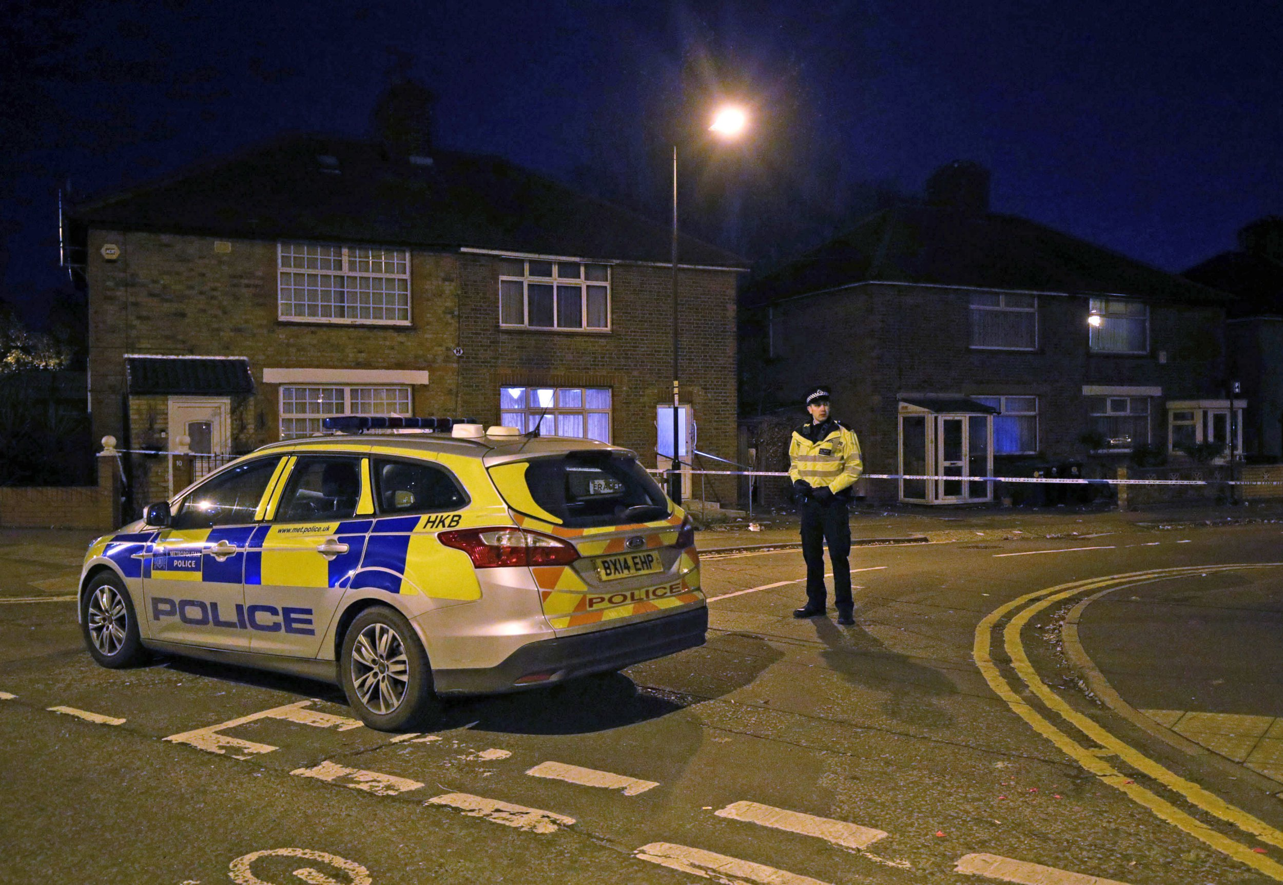 Police at the scene in Edmonton, north London after four men in their 20s were hospitalised following a quadruple stabbing. PRESS ASSOCIATION Photo. Picture date: Sunday November 18, 2018. All the injured men were taken to north London hospitals, with police waiting for an update on their condition. Two vehicles that had been in a collision were also found at the scene. See PA story POLICE Edmonton. Photo credit should read: Yui Mok/PA Wire