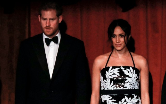 Free usage for UK newspapers - Editorial use only Mandatory Credit: Photo by Matt Frost/ITV/REX/Shutterstock (9984801c) Prince Harry and Meghan Duchess of Sussex during the National Anthem The Royal Variety Performance, Show, London Palladium, UK - 19 Nov 2018