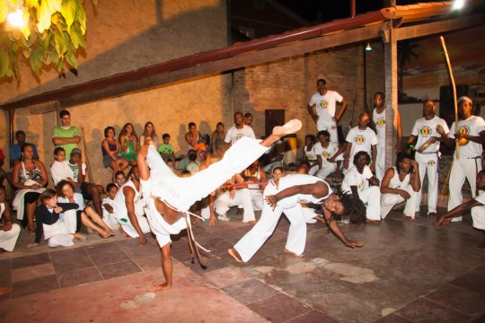The Brazilian martial arts/dance practice of Capoeira. It is a ritual that began on the African slave ships to keep fit and in fighting shape.