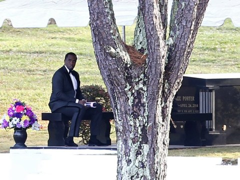 Diddy sits alone by ex Kim Porter's grave site during private funeral