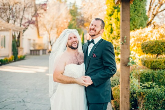 """The hilarious moment groom David Hofffman,32, turned around expecting to see his wife-to-be Brianne Dennis,29, for the first time on their wedding day- and instead saw his best friend Timmy Horton,37, in a wedding dress! Lord Hill Farms in Snohomish, Washington, USA, November 17,2018. .See SWNS story SWNYlook.Hilarious photos show a groom in fits of laughter after he turned to look at his bride on their wedding day - and found his bearded best man standing there instead.David Hofmann, 32, was expecting to see his wife-to-be Brianne Dennis, 29, in her white gown, but she had traded places with their friend Timmy Horton, 37.Photographer Anna Morrison captured the moment David creased in hysterical laughter after seeing his bearded pal wearing a veil and squeezed into a dress. David, an electrician, said: """"Right in that moment I was anxious. I was trying to calm my nerves because I was about to see my bride for the first time."""