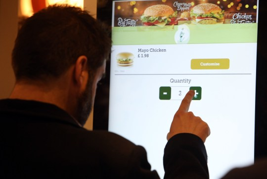 LONDON, UNITED KINGDOM, NOVEMBER 28TH 2018. Metro reporter Adam Smith is pictured using the self-service machines at McDonald's in High Street Kensington in London, 28th November 2018. Dr. Paul Matewele, Doctor and researcher of Microbiology and Immunology in the London Metropolitan University School of Human Sciences, has discovered several forms of bacteria on the self-service machines in McDonald's fast food restaurants around the country. Photo credit: Susannah Ireland
