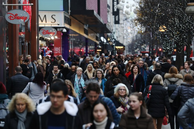 Shoppers make their way down Oxford Street in London, U.K., on Thursday, Dec. 21, 2017. U.K. consumer confidence slipped to a four-year low in December and risks weakening further in 2018, according to a GFK UK Consumer Confidence Indicator report. Photographer: Luke MacGregor/Bloomberg via Getty Images