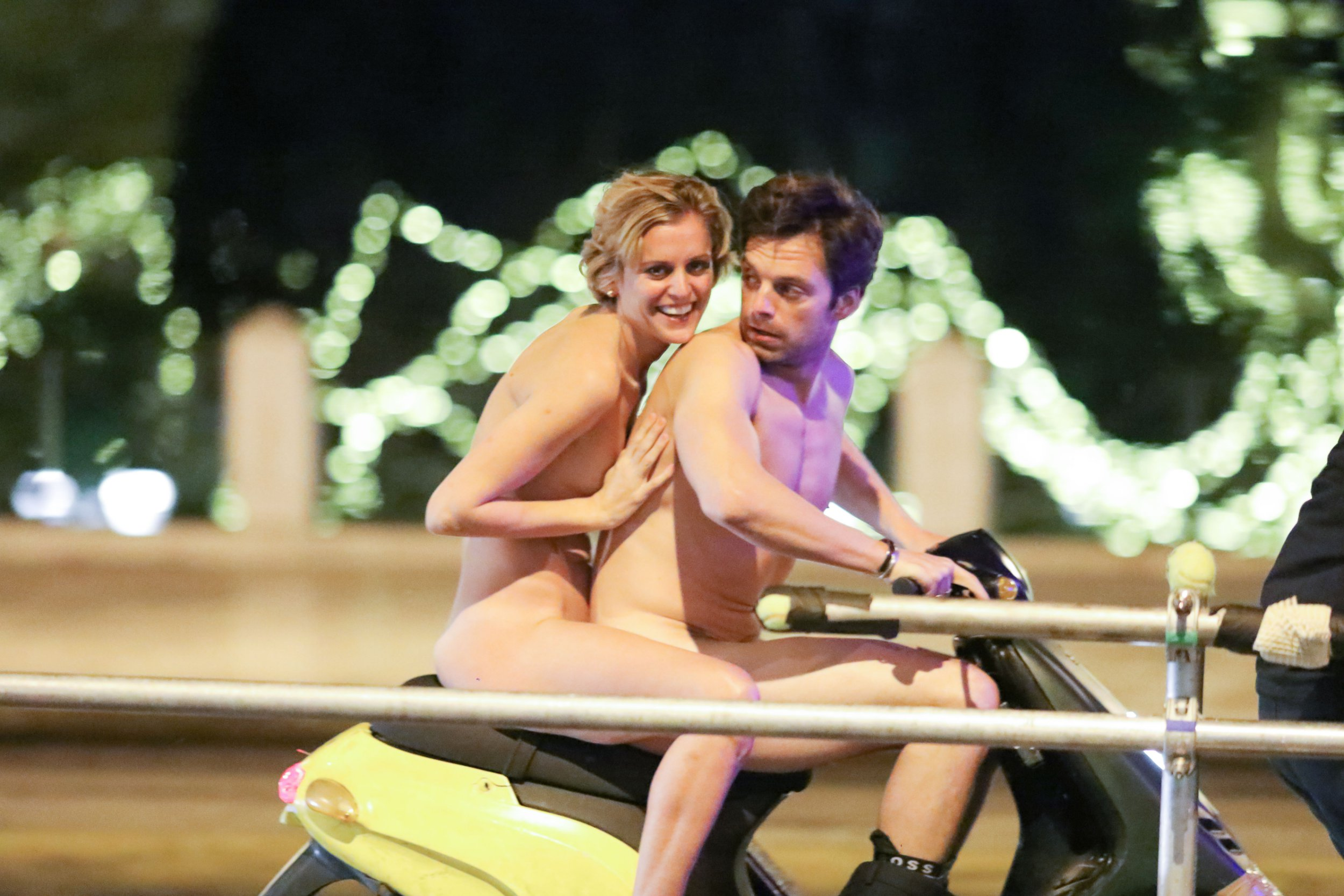 "EXCLUSIVE PICTURES - US actor Sebastian Stan and Irish Actress Denise Gough are completely nude riding on a scooter through the centre of Athens while filming scenes for their upcoming movie ""Monday"" on November 28th 2018 in Athens, Greece."