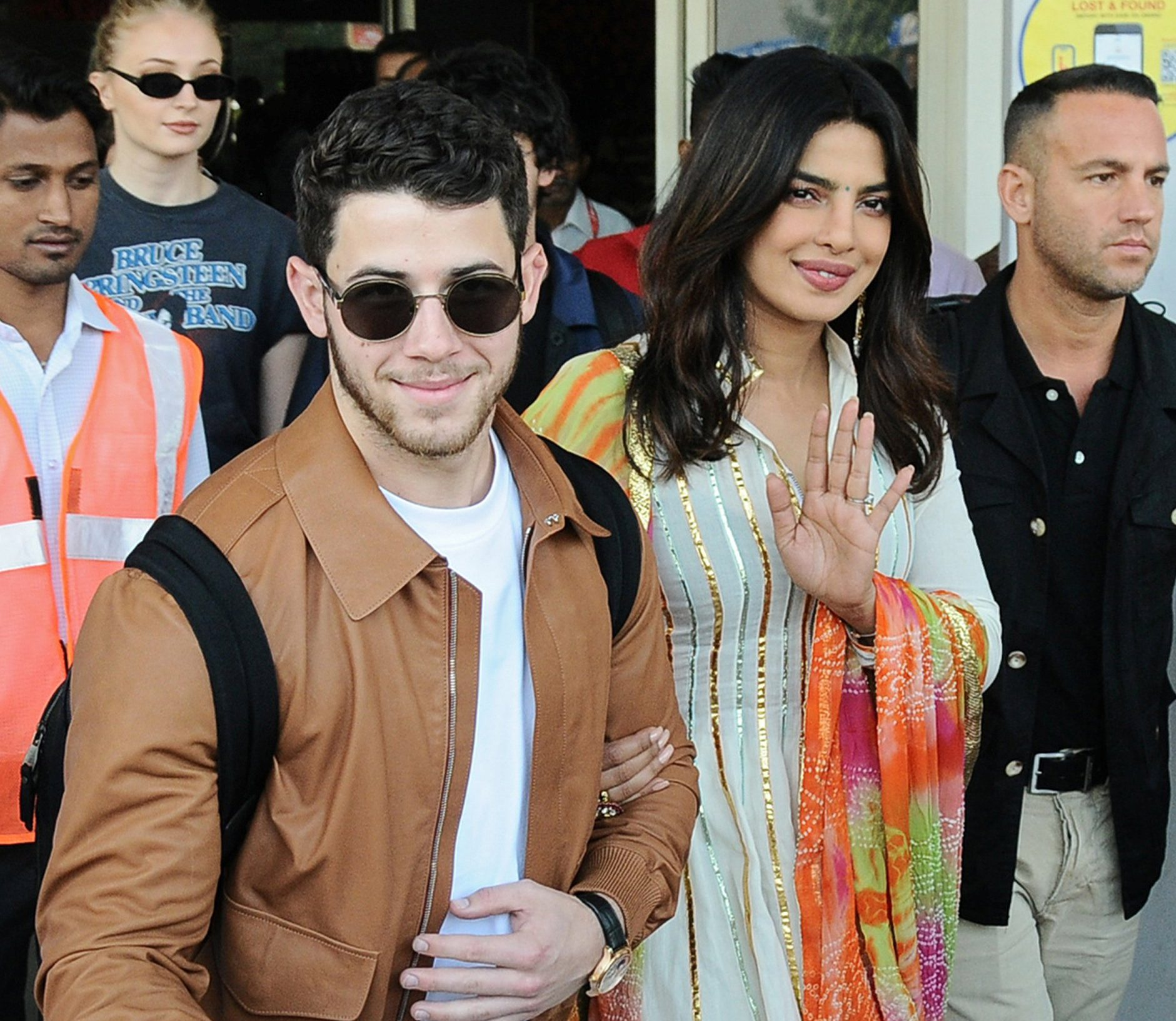 Bollywood actress Priyanka Chopra and singer Nick Jonas wave as they arrive at the airport in Jodhpur in the desert state of Rajasthan, India, November 29, 2018. REUTERS/Stringer