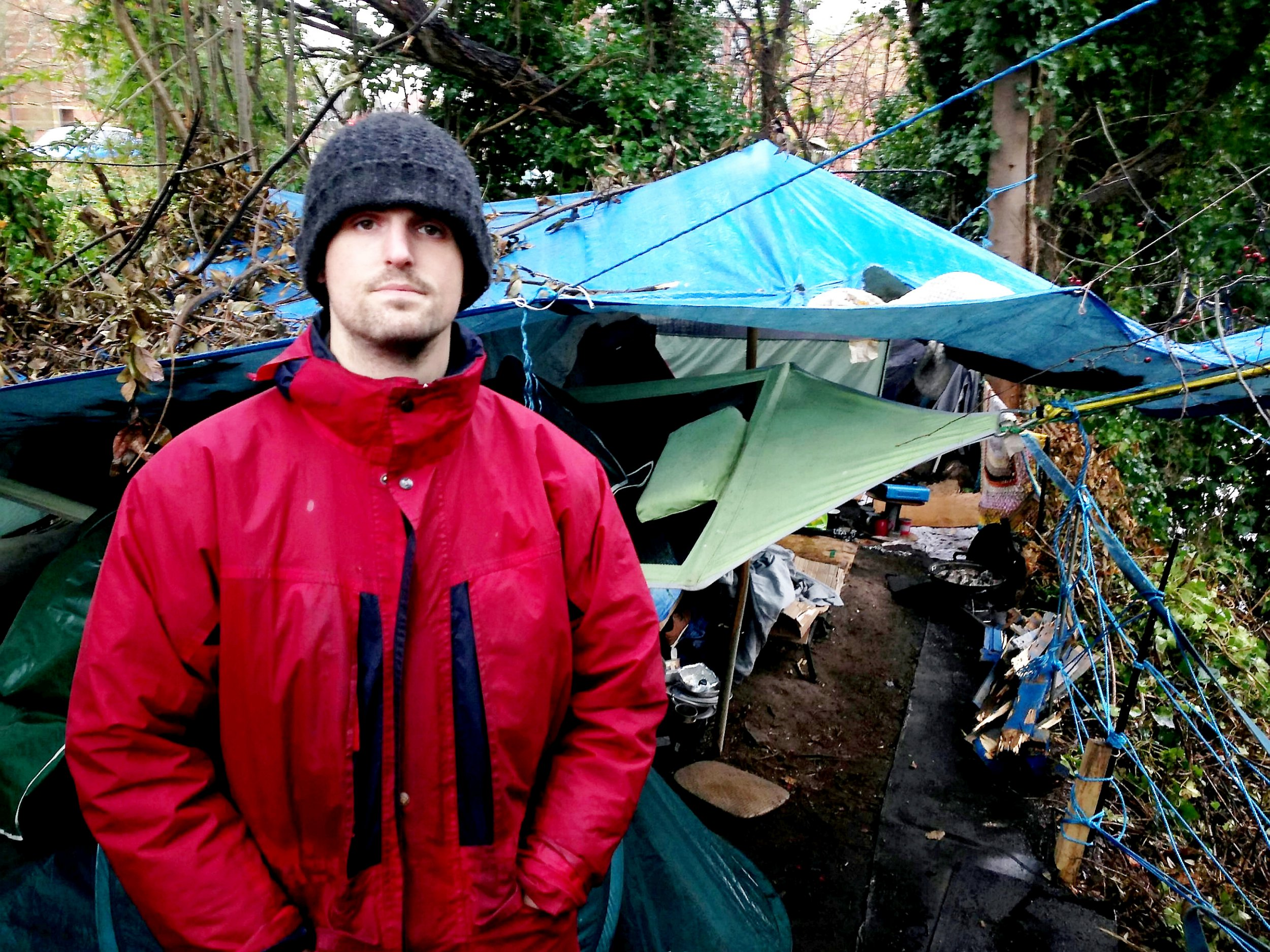 Former soldier, Jake, who has lived at the camp for a couple of months. A war hero who fought in Afghanistan is now homeless and living in a makeshift shack on a river bank after he was diagnosed with PTSD. See SWNS story SWMDsoldier. The squaddie, known only as Jake, left the Army after struggling to cope with seeing pals blown up by bombs in Helmand Province. The 27-year-old, who served for six years, moved into temporary accommodation but became homeless when his relationship broke down in the summer. The former tank driver is now living with a group of other homeless people in a makeshift camp by a river in Worcester. Jake now uses his military training to help the group gather wood, make shelter and keep warm.