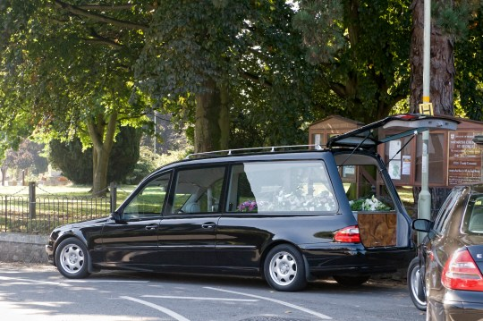 Baby found dead in the road after falling off roof of a hearse (Stock Image) Pontesbury, Shropshire, UK - September 25th 2008. Black hearse outside Pontesbury church during a family funeral