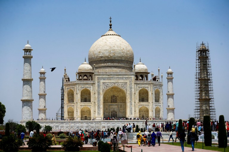 AGRA, INDIA - APRIL 29: Tourists are seen as renovation process continue at Taj Mahal, one of the wonders of the world, in Agra, India on April 29, 2017. Restoration work goes on its central dome which has become dirtied by pollution in recent year. (Photo by Ahmet zgi/Anadolu Agency/Getty Images)